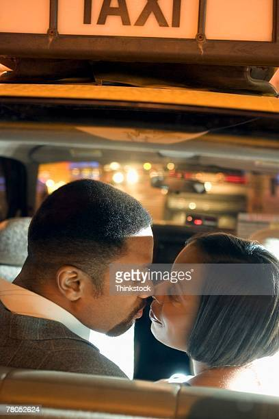Couple kissing in taxicab