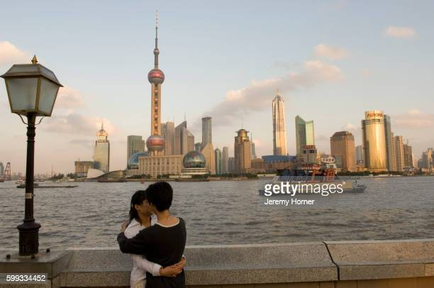 Couple Kissing next to Huangpu River