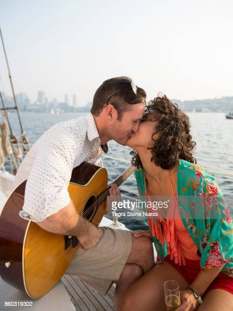 Couple Kissing on a Sailboat