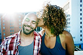 Couple kissing on urban rooftop