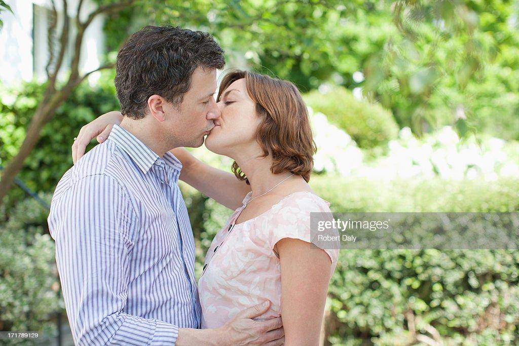 Couple kissing outdoors : Stock Photo