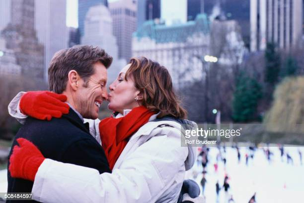 Couple kissing outside Rockefeller Center, New York City, New York, United States