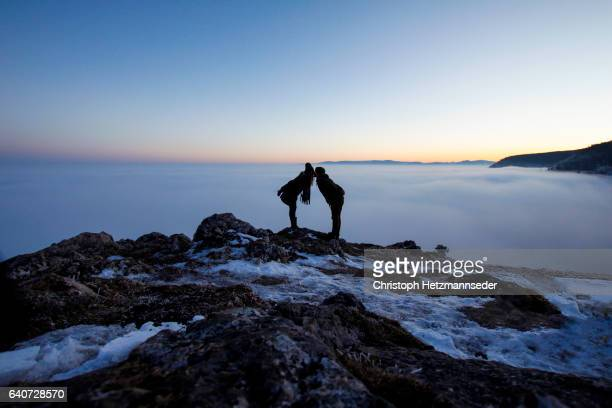 Couple kissing over the clouds