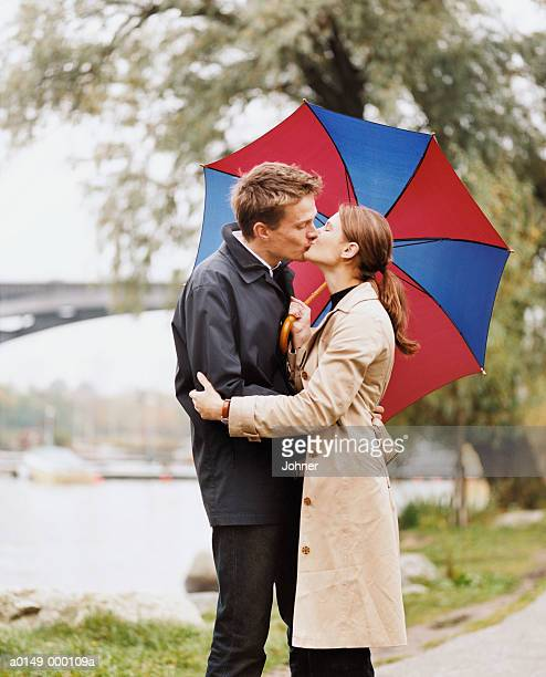 Couple Kissing Rain Stock Photos And Pictures