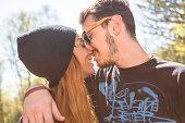 Couple kissing, woman wearing knit hat