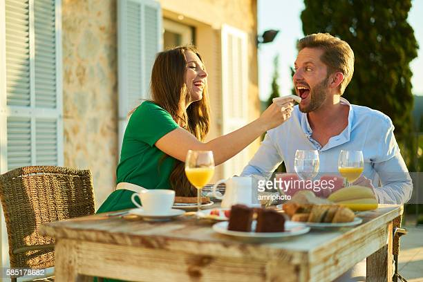 couple laughing and having fun during breakfast