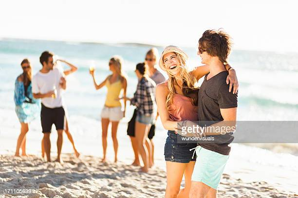 Couple Laughing At A Beach Party
