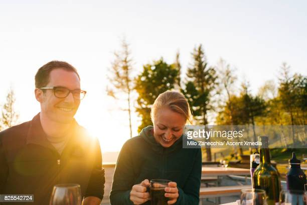 Couple laughing drinking tea