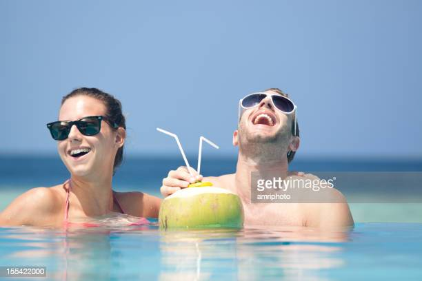 couple laughing happy pool