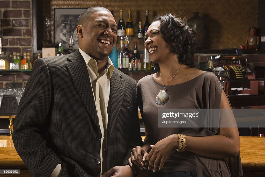 Couple laughing in bar : Stock Photo
