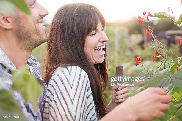 Couple laughing on allotment
