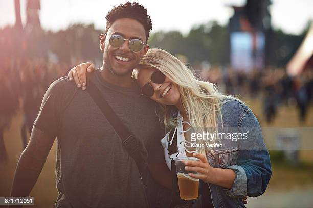 Couple laughing together at concert