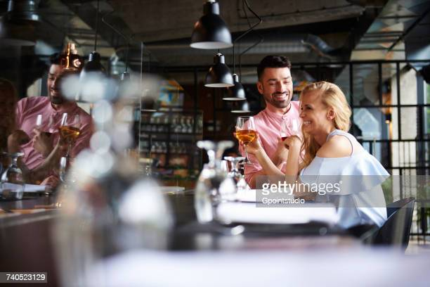 Couple laughing together at restaurant table