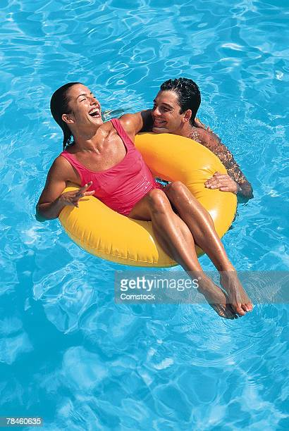 Couple laughing together in pool