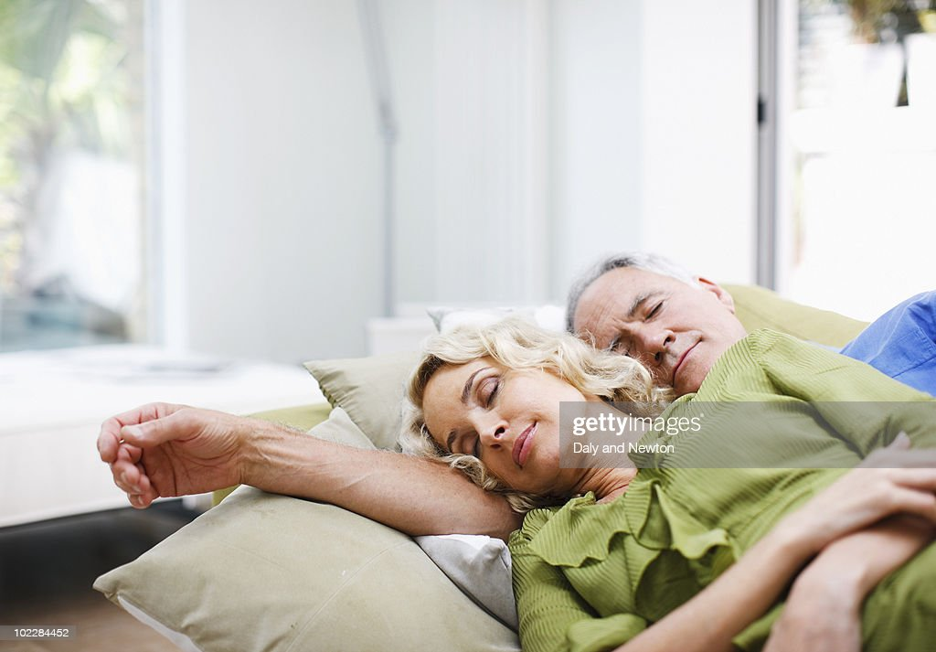 Couple laying on sofa together : Stock Photo