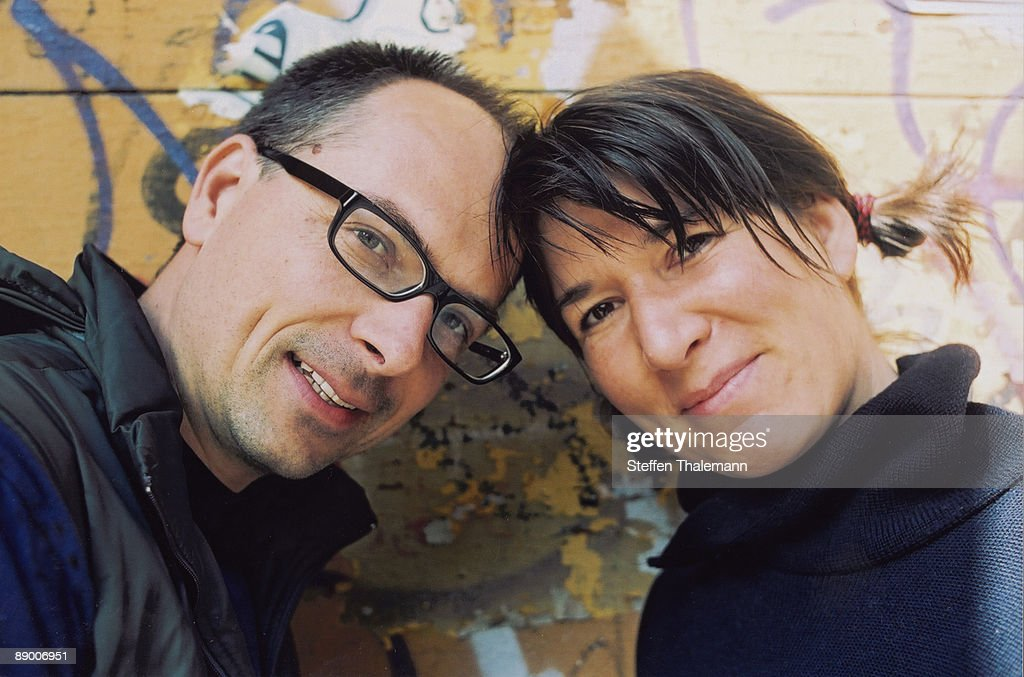 Couple leaning heads together : Stock Photo