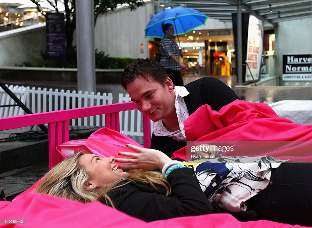 A couple lie in bed during the The World's Biggest Breakfast in Bed Guinness World Record Attempt at Martin Place on March 2, 2012 in Sydney, Australia.