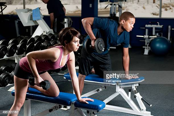 Couple Lifting Weights at the Gym