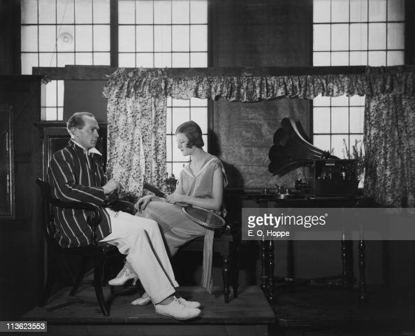A couple listening to an early Marconi wireless set 1923