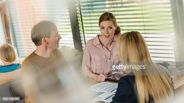 Couple listening to financial advisor