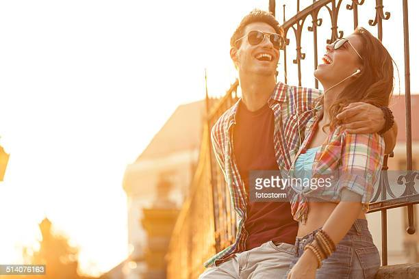 Couple listening to music on mobile phone together