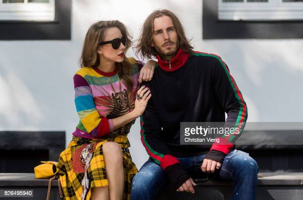 Couple look a like Model and Blogger Alexandra Lapp wearing a yellow and red pleated tartan skirt embroidered with a spaniel dog and belt buckle...