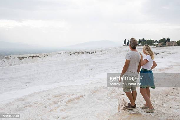 Couple look across travertine formations