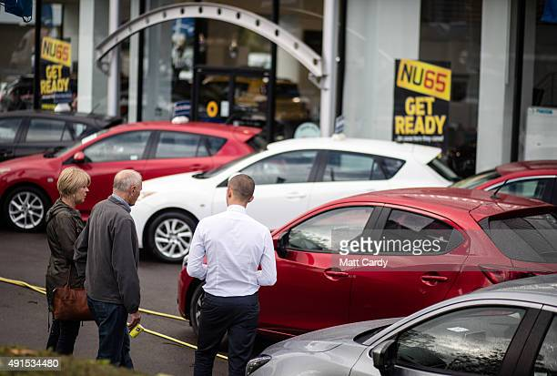 A couple look at a brand new Mazda car that is offered for sale on the forecourt of a main motor car dealer in Brislington on October 6 2015 in...