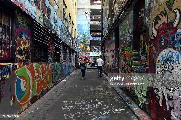 A couple look at graffiti on the walls of Rutledge Lane in Melbourne on March 26 2015 Hosier and Rutledge Lane off Flinders street is a much...