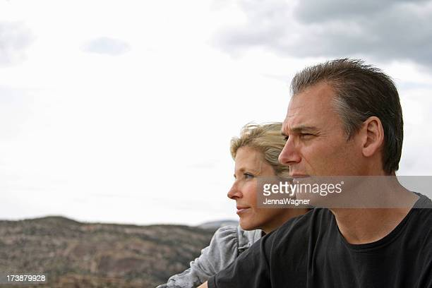 Couple look out across the landscape