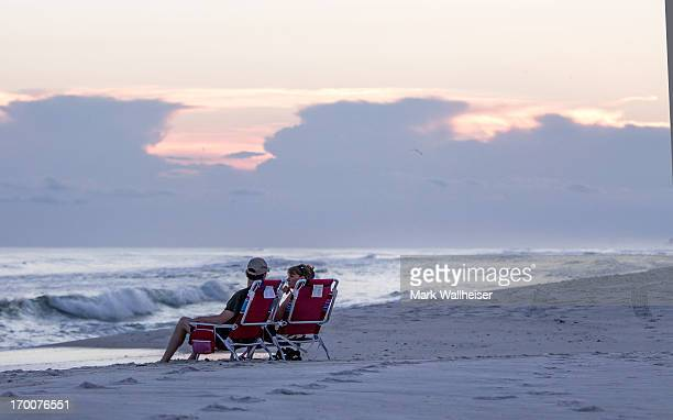 A couple look out over the surf as the skies clear June 6 2013 at Laguna Beach west of Panama City Beach Florida Tropical storm Andrea the first...