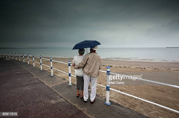 PHOTO A couple look out to sea at Weymouth seafront on August 31 2008 in Weymouth England Forecasters have claimed that this August has been one of...