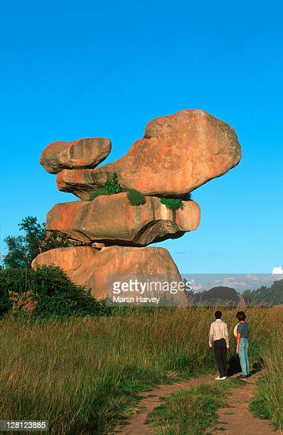 Couple looking at Balancing rocks outside Harare, Zimbabwe.
