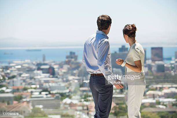 Couple looking at city view from a terrace