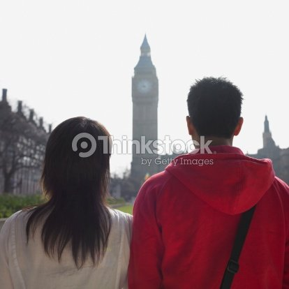 couple looking at clock tower in london stock photo thinkstock