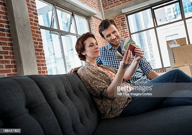 Couple looking at color swatches in new apartment