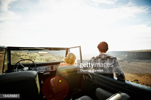 Couple looking at desert landscape from vehicle : Stock Photo