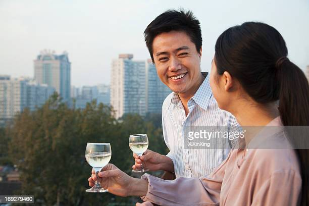 Couple Looking at Each Other with Cityscape