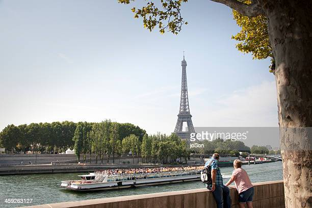 Couple looking at Eiffel Tower and the Sein River