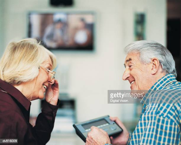 Couple Looking at Electronics