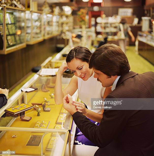 Couple looking at engagement rings in jewelry store