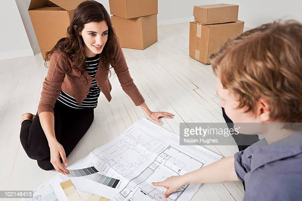 Couple looking at floorplan and paint swatches