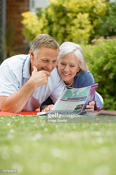 Couple looking at holiday brochure