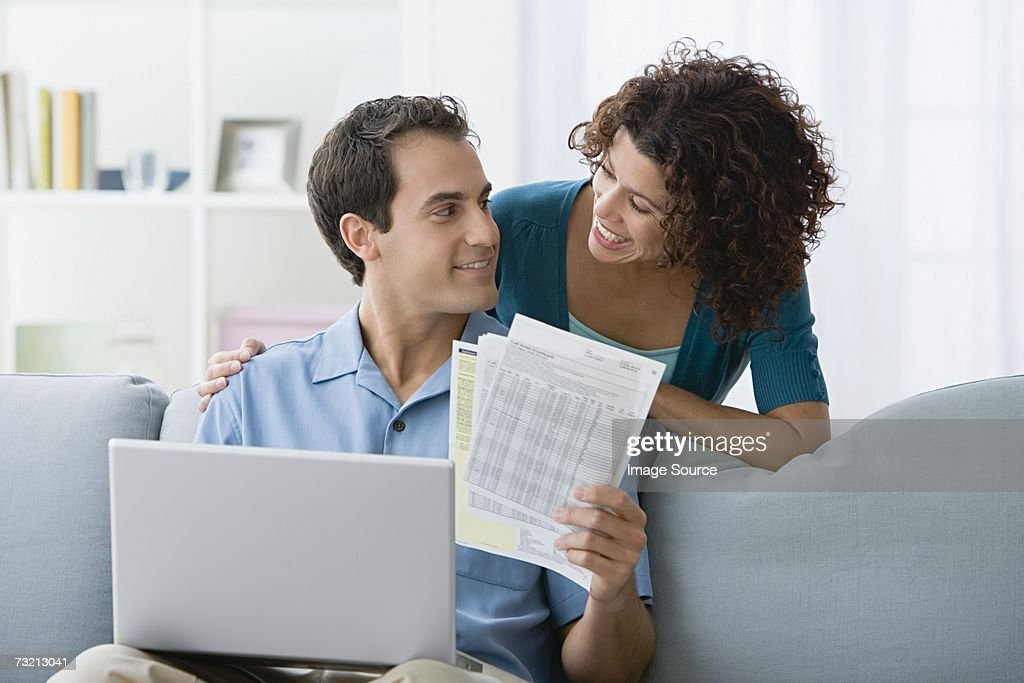 Couple looking at home finances on computer : Stock Photo