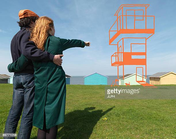 Couple looking at imaginary house