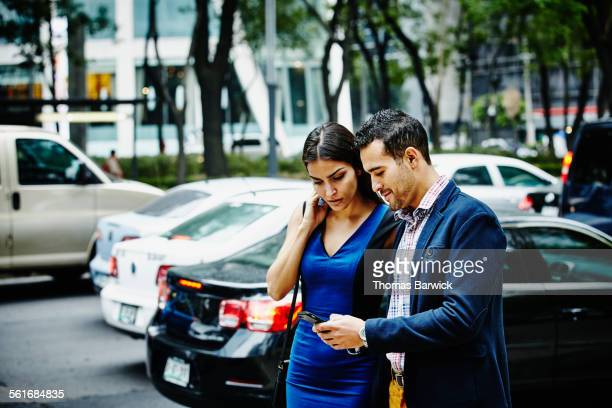 Couple looking at information on smartphone