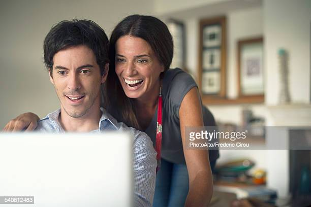 Couple looking at laptop computer together