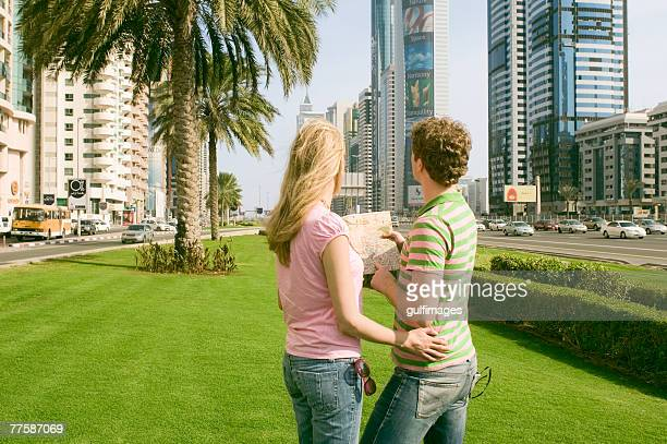 Couple looking at map, United Arab Emirates