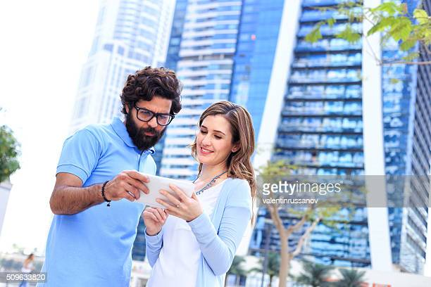 Couple looking at phone for direction - Dubai