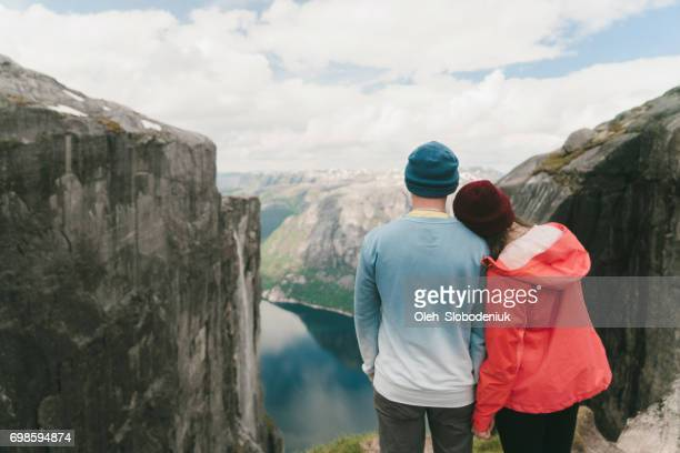 Couple looking at scenic view of Lysefjorden from Kjerag mountain